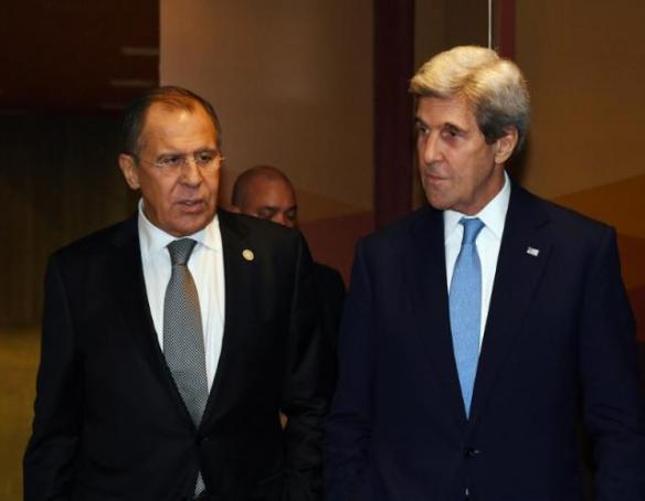 Russian Foreign Minister Sergey Lavrov and U.S. Secretary of State John Kerry leave after their bilateral meeting at the APEC Ministers Summit in Lima