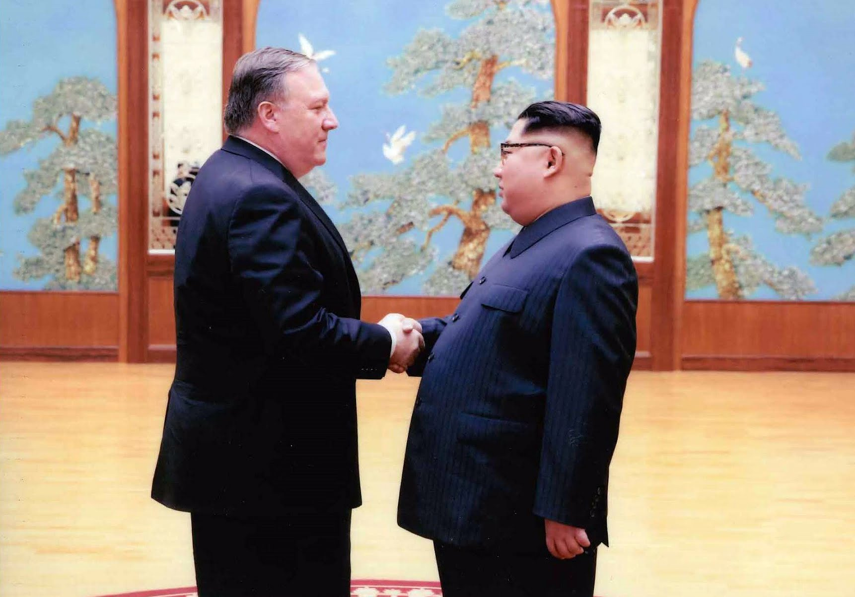 c2f853c331a Then Director of the Central Intelligence Agency, Mike Pompeo (left) and  Supreme Leader of the Democratic People's Republic of Korea, Kim Jong-un ( right).